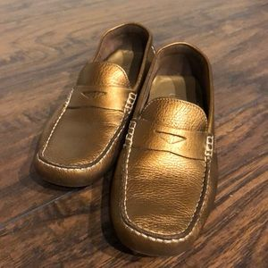 Cole Haan Gold leather loafers.